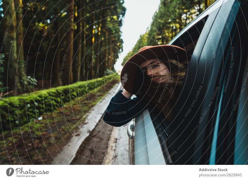 Woman hanging out of car in forest Car Window Forest Green Dream Hat Street