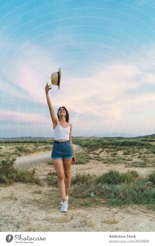 Woman throwing up hat in nature Field pretty throw up Hat Beautiful Girl Nature Beauty Photography Youth (Young adults) Summer Happy Portrait photograph Sand