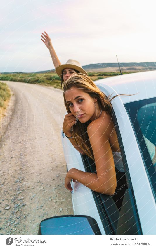 Women hanging out of car Woman Car Nature Looking into the camera Window Field Joy Lifestyle Youth (Young adults) Happy Vacation & Travel Vehicle Human being