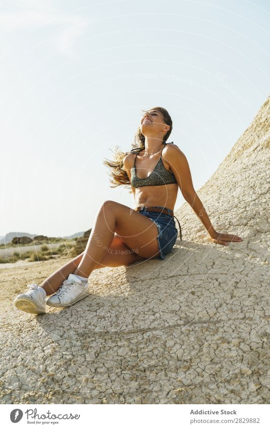 Attractive woman on ground Woman Smiling Ground Sit Cheerful Sand Happy Lifestyle