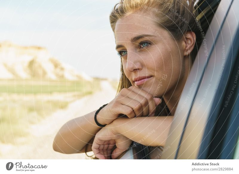 Woman looking out of car window Car Window riding Passenger Youth (Young adults) Vehicle Trip Vacation & Travel Girl Human being Street Beautiful Face Transport