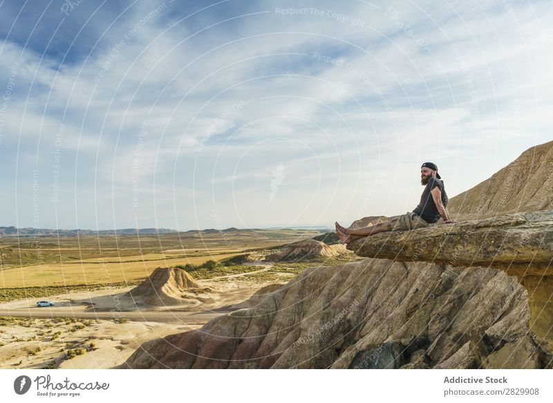 Man relaxing on cliff Cliff Sit Relaxation Edge Vacation & Travel Adventure Rock Mountain Tourist Freedom Vantage point Top Extreme Action Peak Nature Hiking