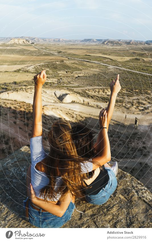 Excited women lying on cliff Woman Cliff Relaxation Vacation & Travel Adventure Rock Mountain Tourist Friendship Together Smiling Happy Excitement Freedom