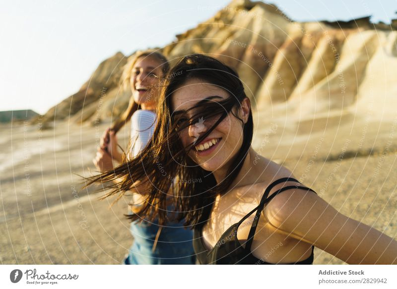 Pretty women walking at hill Woman Excitement Looking into the camera flying hair Walking Cheerful Freedom Vacation & Travel Success Top Mountain