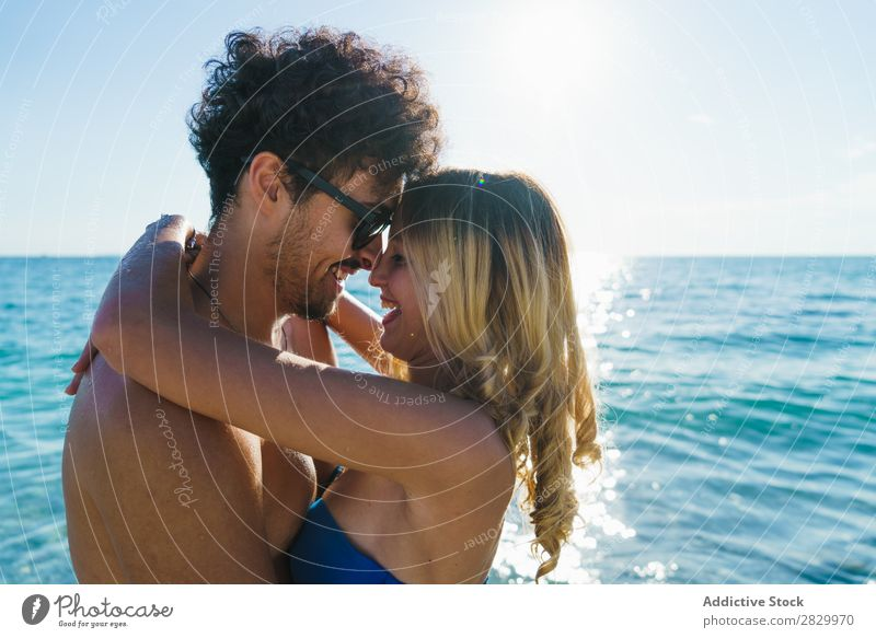 Loving couple posing on beach Couple Beach Love Honeymoon Summer Paradise Exotic romantic Ocean Embrace Tropical Beauty Photography enjoyment Sun