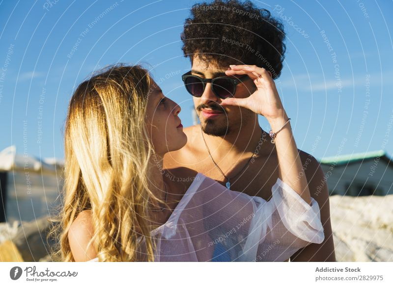 Gentle couple posing on beach Couple Beach Posture Style Ocean Honeymoon Considerate Happiness Love Together Traveling Set Summer Relaxation Sunglasses