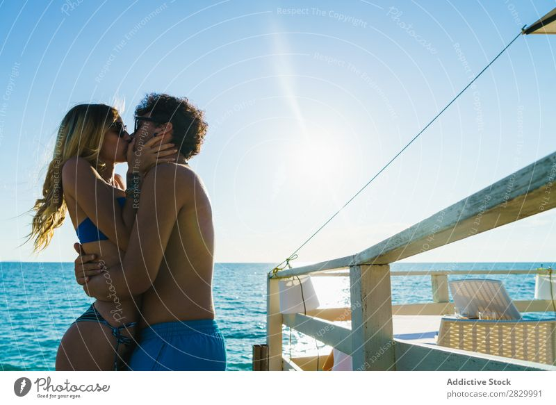 Embracing loving couple on beach Couple Beach embracing Love Resort Honeymoon Exotic Tropical Together enjoyment Paradise 2 Body Relationship romantic