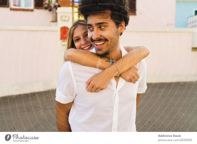 Man carrying young girl on back Couple Street Happiness Carrying City romantic Love Hold Summer Laughter Playful loving Expression Together Relaxation embracing
