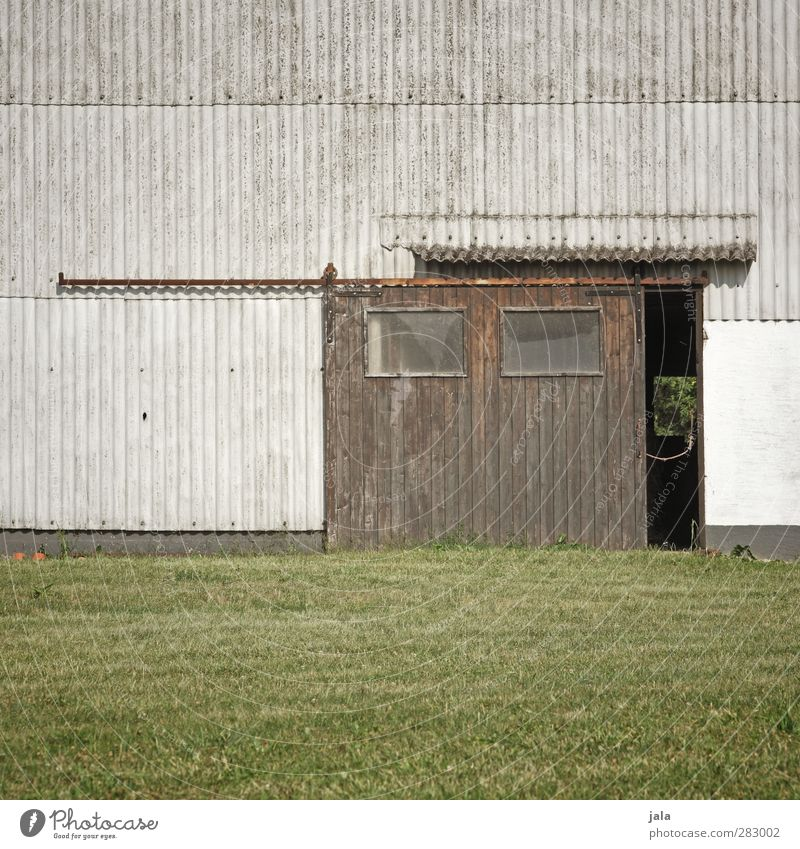 Plant Meadow Wall (building) Grass Wall (barrier) Building Facade Gloomy Manmade structures Gate Barn Barn door