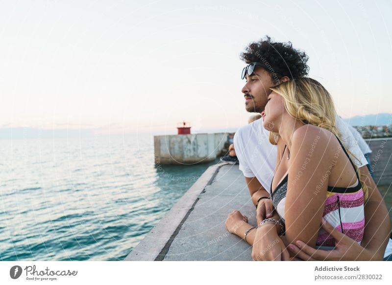 Gentle couple enjoying ocean view Couple Jetty Ocean embracing Relaxation Resort romantic Vacation & Travel Summer Together Nature Leisure and hobbies Love