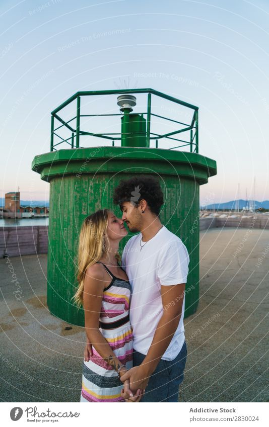 Loving couple posing in dock Couple romantic loving Kissing Posture Honeymoon Coast Romance Together Youth (Young adults) embracing Relaxation Traveling