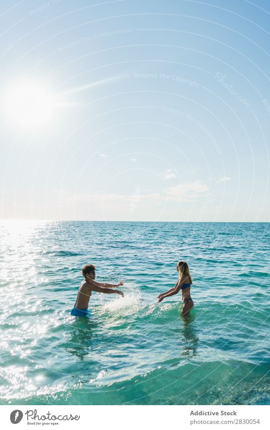 Couple posing in ocean water Ocean Swimming Summer Exotic romantic Water Love Tropical Beauty Photography enjoyment Sun Vacation & Travel Honeymoon Paradise