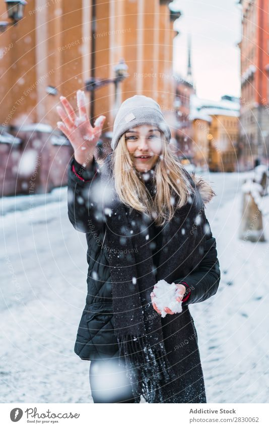 Woman throwing up snow Style Street Snow falling Joy fashionable To enjoy Youth (Young adults) pretty Winter Cold Cool (slang) Fashion warm clothes City Model