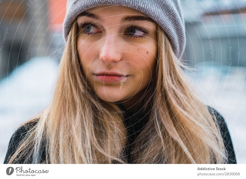 Pretty woman posing in winter town Woman Style Street Snow fashionable To enjoy Youth (Young adults) pretty Winter Cold Cool (slang) Fashion warm clothes City