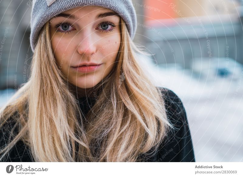 Pretty woman posing in winter town Woman Style Street Snow Looking into the camera fashionable To enjoy Youth (Young adults) pretty Winter Cold Cool (slang)