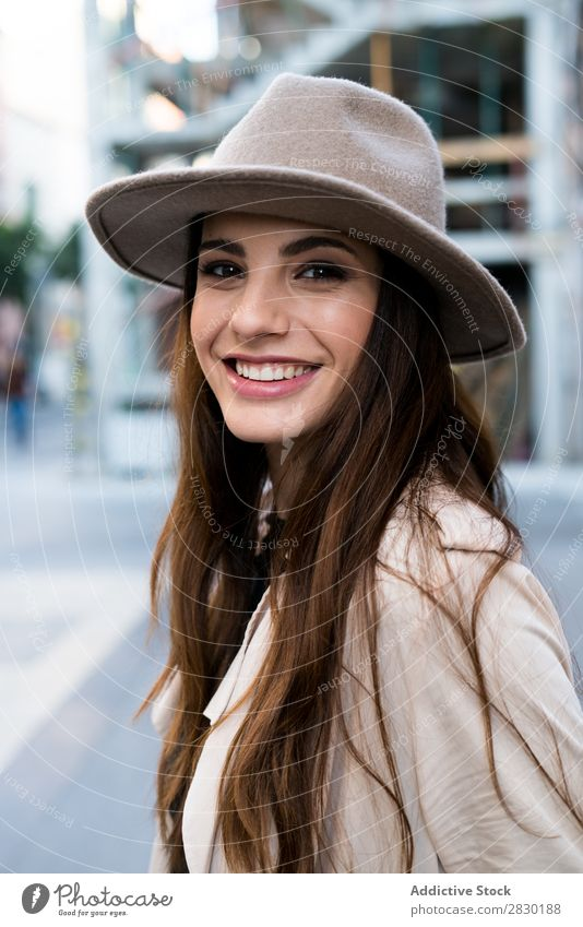 Young smiling woman wearing hat Woman Cool (slang) Cheerful Smiling Looking into the camera Style Hat Street Posture pretty Beautiful Fashion Model Girl
