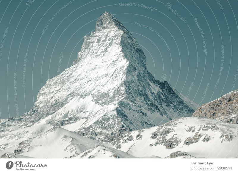 Majestic and impressive: Matterhorn Vacation & Travel Winter Nature Snow Alps Mountain Peak Exceptional Large White Blue sky Europe Switzerland Canton Wallis