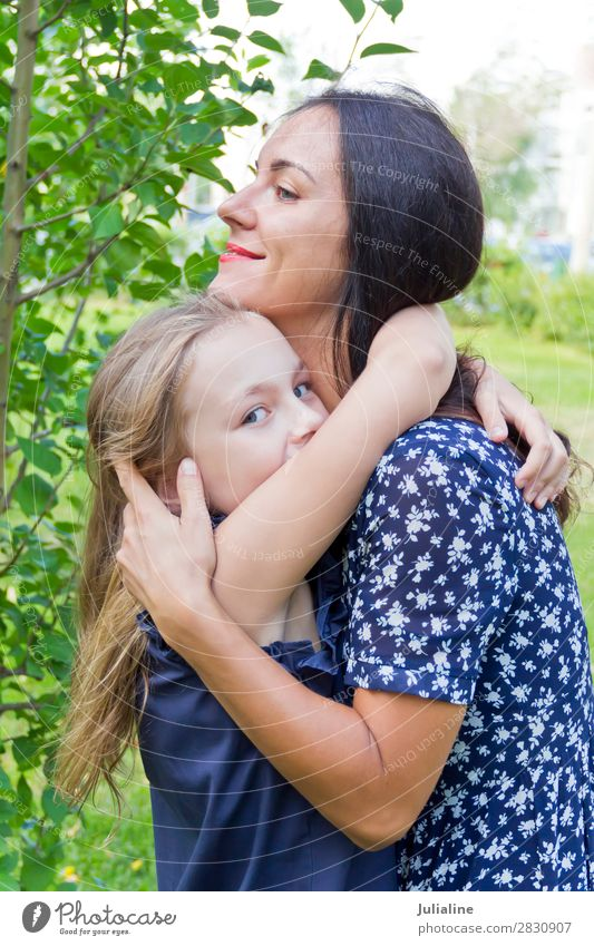 Kissing mother and daughter in summer Summer Child Schoolchild Woman Adults Parents Mother Infancy 18 - 30 years Youth (Young adults) Brunette Blonde Smiling