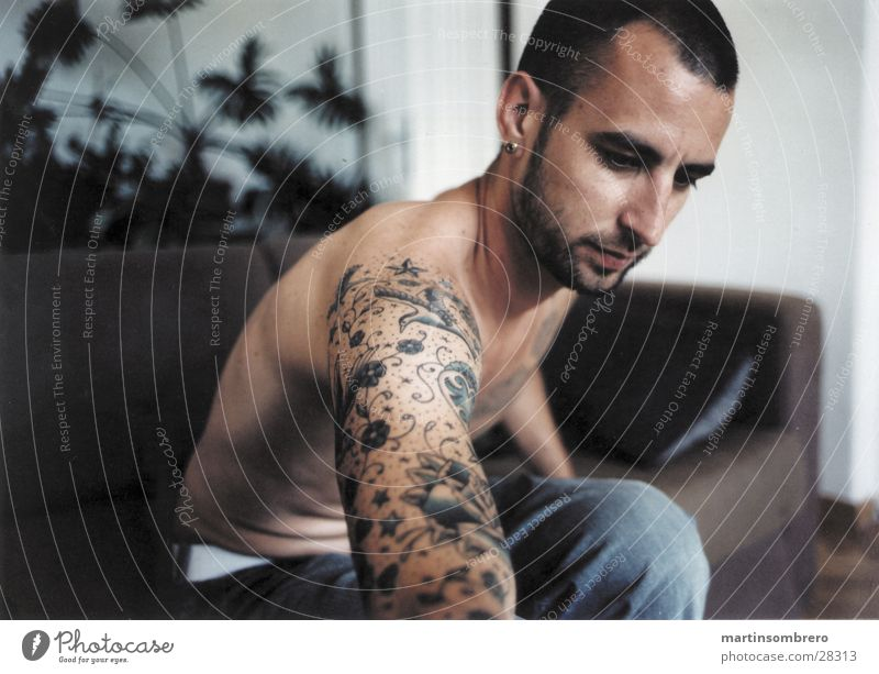 tatoo Tattoo Man Sofa Living room Flat (apartment) Skin afternoon light steam out a cigarette upper body naked Interior shot