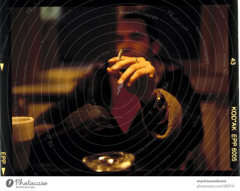 smoke Ashtray Cozy Man hand holding a cigarette depth blur Smoking Evening Interior shot