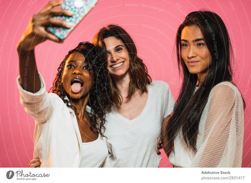 Women taking selfie in studio Woman pretty Portrait photograph Youth (Young adults) Friendship Selfie PDA Black asian diversity multiethnic Mixed race ethnicity