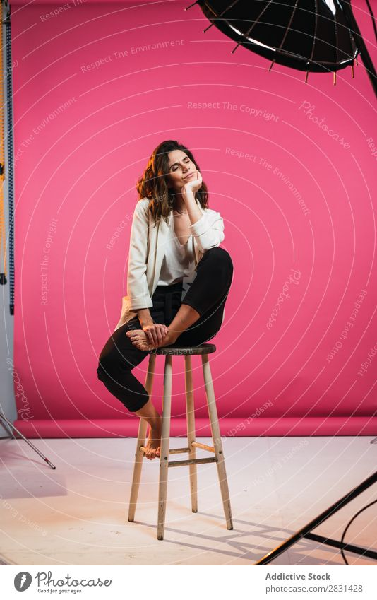 Woman on stool in studio pretty Portrait photograph Youth (Young adults) Sit Stool eyes closed Beautiful Adults Posture Smiling Beauty Photography Attractive
