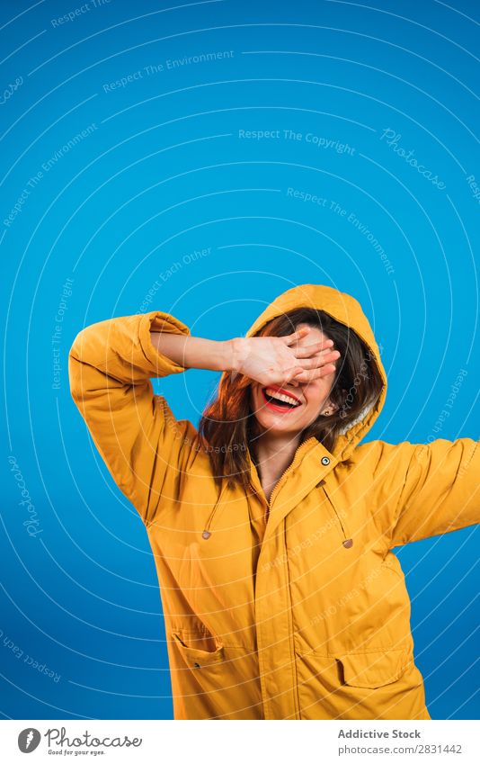 Cheerful woman in yellow jacket Woman pretty Portrait photograph Youth (Young adults) Jacket Smiling closing face Hand Beautiful Adults Posture