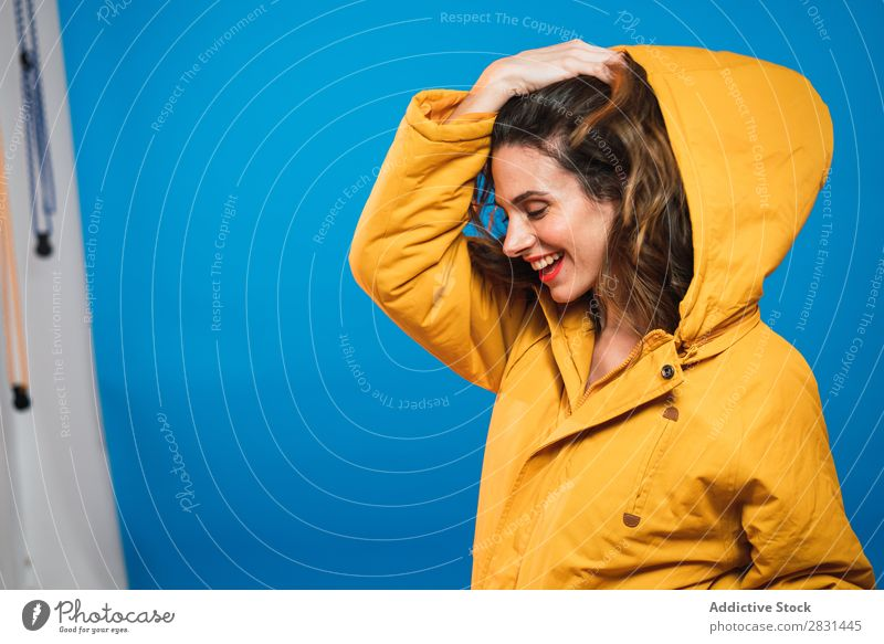 Cheerful woman in yellow jacket Woman pretty Portrait photograph Youth (Young adults) Jacket Smiling Beautiful Adults Posture Beauty Photography Attractive