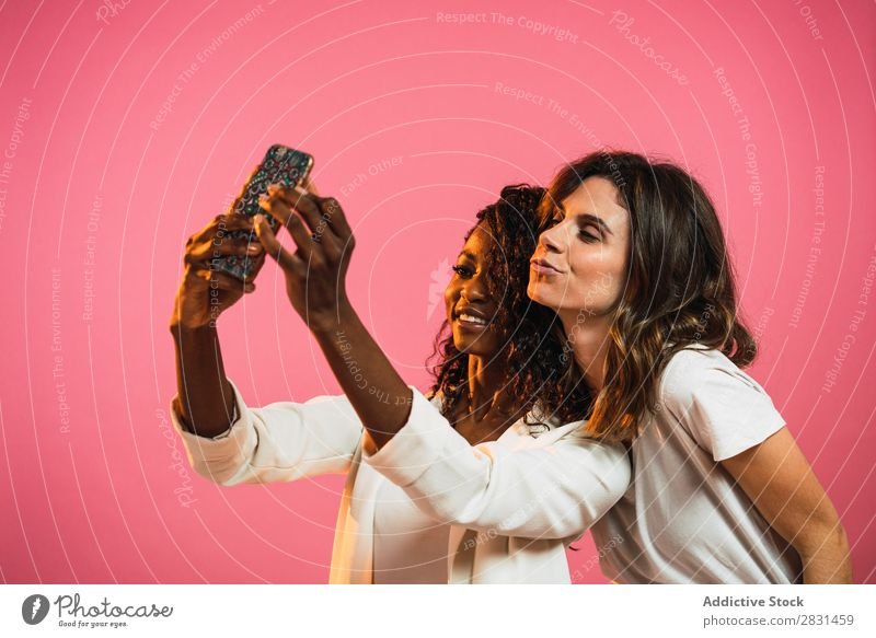 Cheerful women posing for selfie Woman Portrait photograph Youth (Young adults) Friendship Selfie PDA Black Mixed race ethnicity
