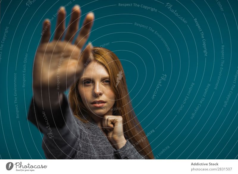 Attractive woman showing hand Woman pretty Portrait photograph Youth (Young adults) Stop Gesture Hand Indicate Looking into the camera Sign Beautiful Adults