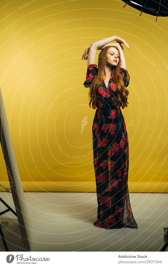 Pretty woman dancing in studio Woman pretty Portrait photograph Youth (Young adults) Beautiful Hands up! Dance Dress Adults Posture Smiling Beauty Photography
