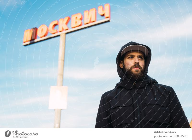 Man standing at post on street handsome City Sign Mail Looking away Street Youth (Young adults) Town Lifestyle Easygoing Fashion Style Adults Modern Human being