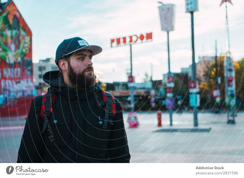 Handsome man looking away on street Man handsome City Street Backpack Looking away Youth (Young adults) Town Lifestyle Easygoing Fashion Style Adults Modern