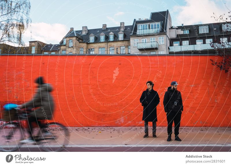 Two men at orange wall Man Stand Orange Wall (building) Together Street handsome City Youth (Young adults) Town Lifestyle Easygoing Fashion Style Adults Modern