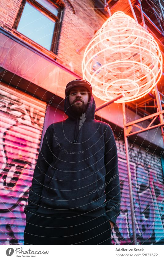 Man posing under neon circle handsome City Neon Stand Street Youth (Young adults) Town Lifestyle Easygoing Fashion Circle Style Adults Modern Human being