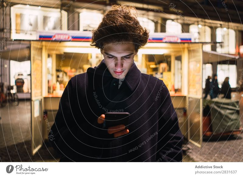 Man browsing smartphone in evening handsome City PDA Selfie Shot Evening Street Youth (Young adults) Town Lifestyle Easygoing Fashion Style Adults Modern