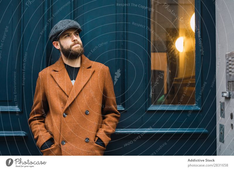 Thoughtful stylish man at door Man handsome City Style Coat Hat Cap Door Considerate Pensive Street Youth (Young adults) Town Lifestyle Easygoing Fashion Adults