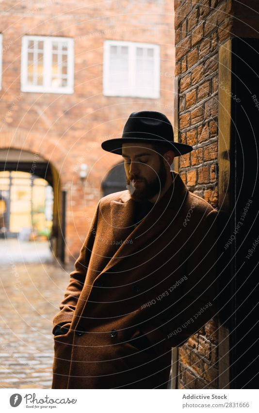 Stylish man leaning on wall Man handsome City Coat Hat Lean Street Youth (Young adults) Town Lifestyle Easygoing Fashion Style Adults Modern Human being