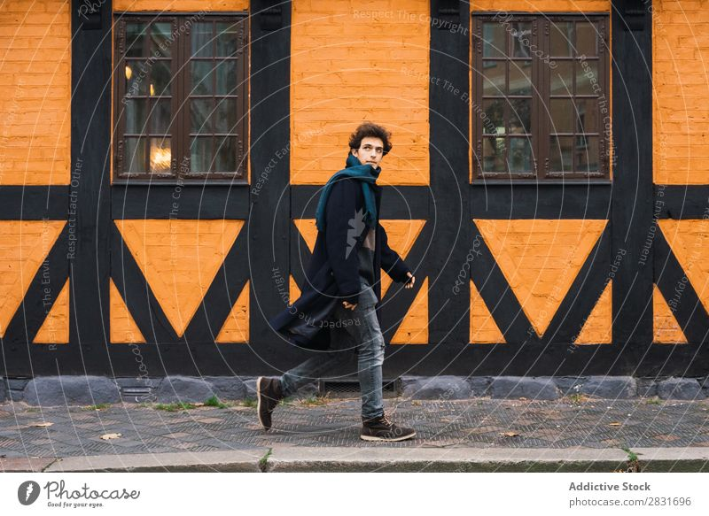 Handsome man walking on street Man handsome City Walking Street Youth (Young adults) Town Lifestyle Easygoing Fashion Style Adults Modern Human being Coat