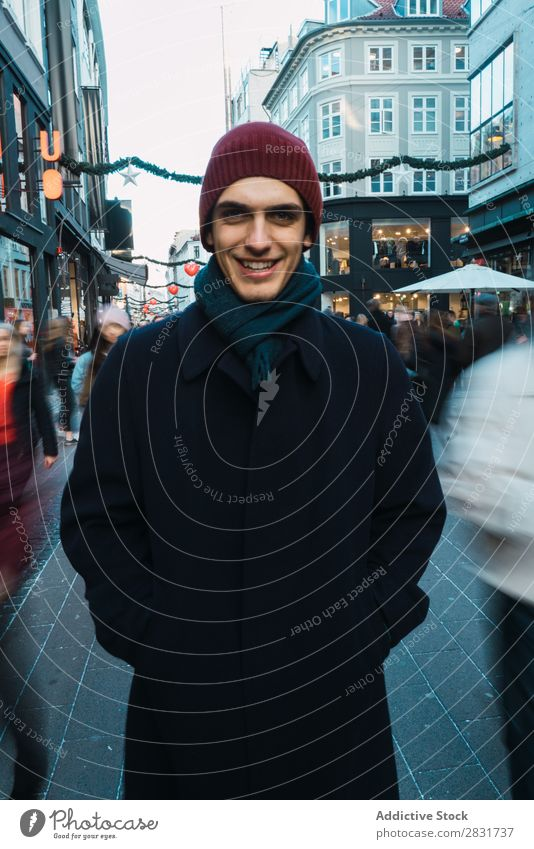 Cheerful man on crowded street Man Smiling Stand Portrait photograph Looking into the camera warm clothes Crowded handsome City Street Youth (Young adults) Town