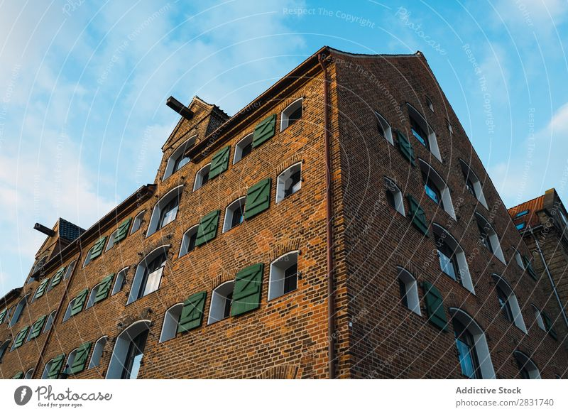 Brick building in city Building City Town Architecture Old Street House (Residential Structure) Vintage Vantage point Dark Exterior Wall (building) Sky Downtown