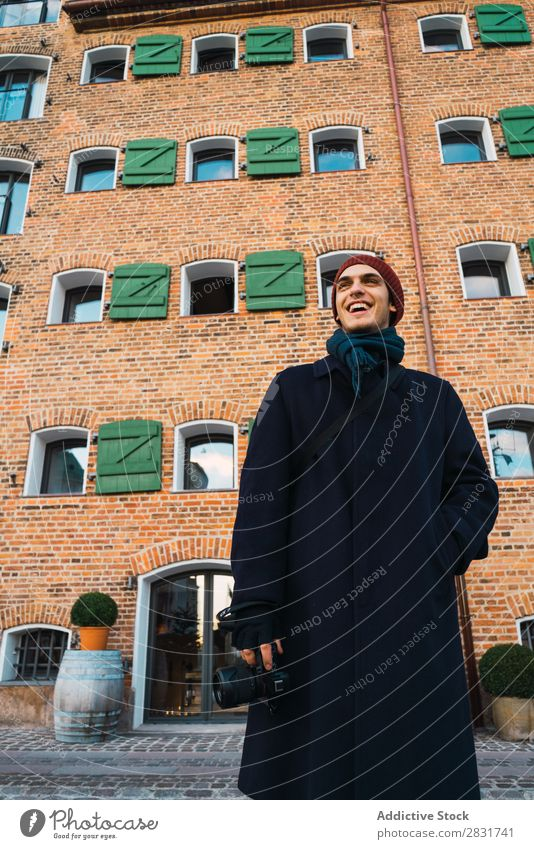 Cheerful photographer on street Man handsome City Street Youth (Young adults) Camera Photographer Brick Building Smiling Town Lifestyle Easygoing Fashion Style