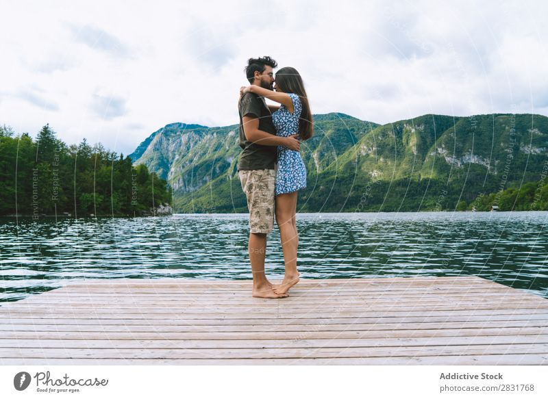 Couple posing on pier Jetty Joy Lake Mountain Happy Love Together Nature Summer Water Youth (Young adults) Woman Vacation & Travel Lifestyle Human being