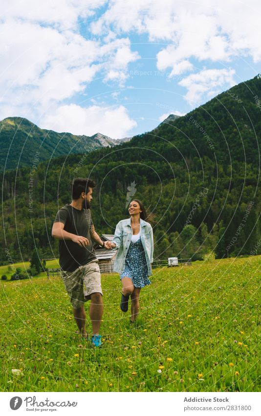 Couple on meadow in hills Meadow Hill holding hands Nature Summer Human being Man Woman Love Grass Beautiful Together Youth (Young adults) Happy Landscape