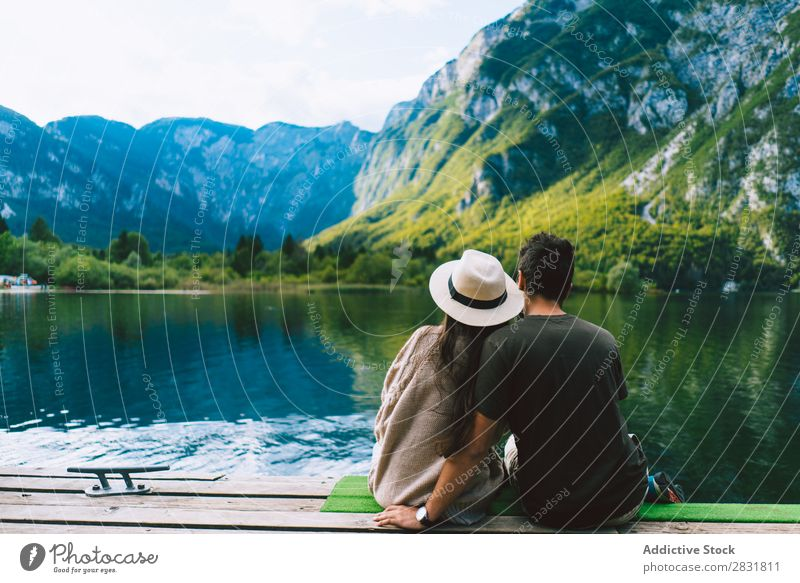 Couple sitting at lake together Lake Human being Nature Vacation & Travel Sit Jetty Love Summer Happy 2 Man Woman romantic Lifestyle Water Romance Beautiful