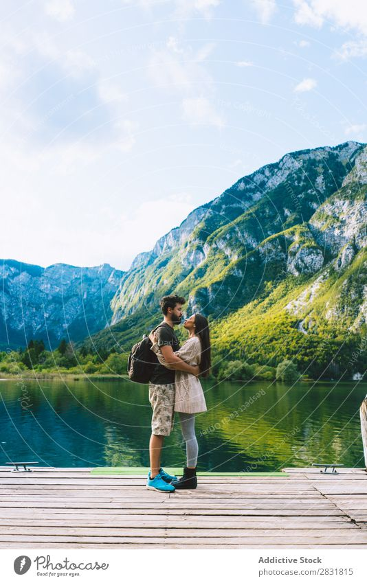 Couple embracing on pier Lake Human being Nature Vacation & Travel Jetty Love Summer