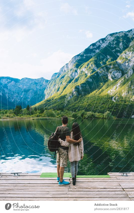 Couple embracing on pier Lake Human being Nature Vacation & Travel Jetty Love Summer Happy 2 Man Woman romantic Lifestyle Water Romance Beautiful