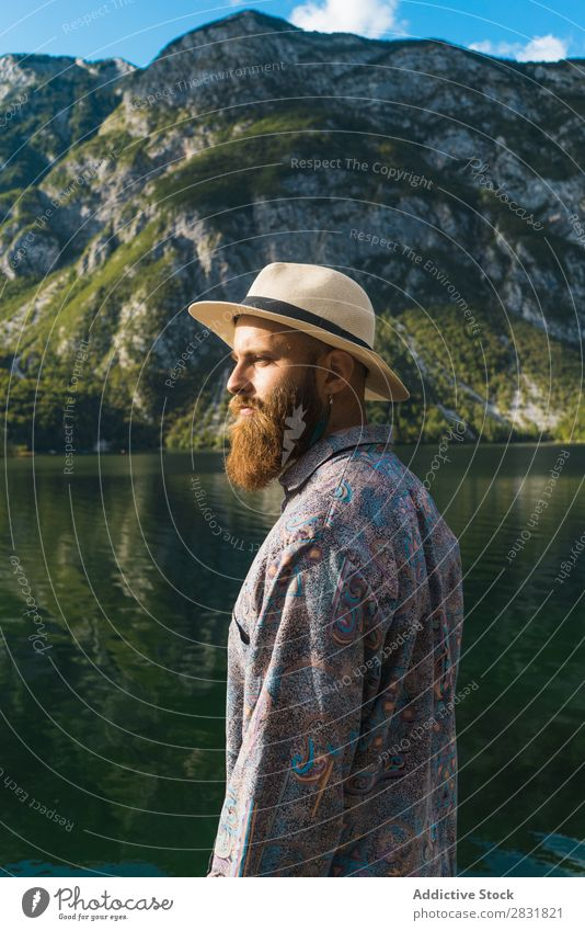 Bearded man standing at lake Man Lake Stand Mountain bearded Water Nature Landscape Human being Tourism Hiking Loneliness Calm Tourist Rock scenery Relaxation