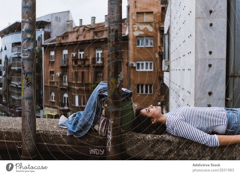 Young pensive woman on bridge fence Human being Fence daydreaming Town Youth (Young adults) Street Summer Considerate Beauty Photography Recklessness