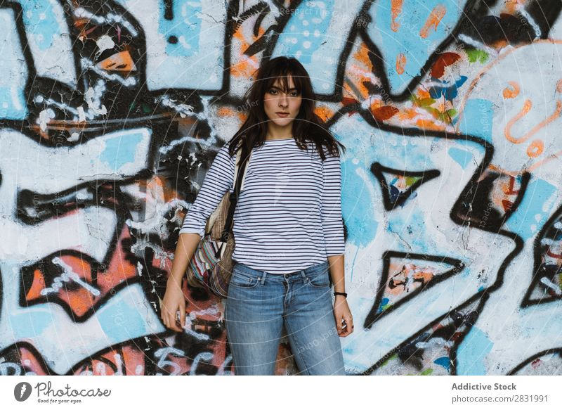 Casual woman on graffiti wall background Human being Easygoing Posture Traveling Graffiti Style Town Beauty Photography Multicoloured Portrait photograph